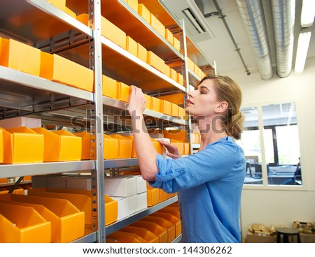Portrait of a pharmacy worker looking for drugs and medicine