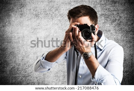 Portrait of a photographer at work - stock photo