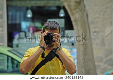 portrait of a photographer with camera. - stock photo
