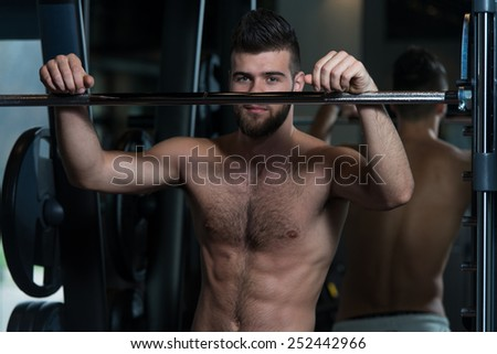 Portrait Of A Physically Fit Young Man Resting In A Health Modern Club - stock photo
