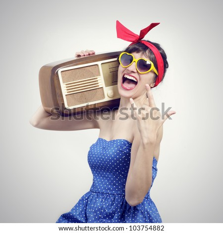 Portrait of a Pin Up listening to the radio - stock photo