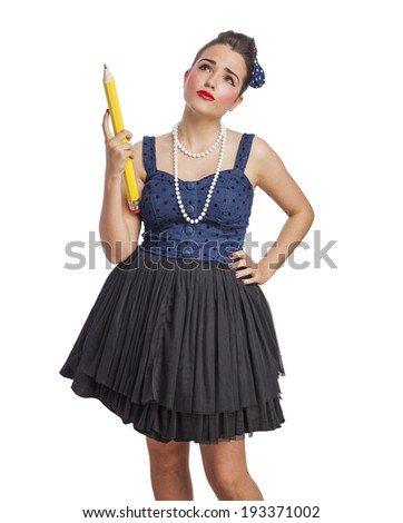 portrait of a pin up woman holding a big pencil - stock photo