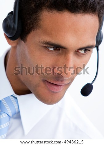 Portrait of a positive businessman with headset on against a white background
