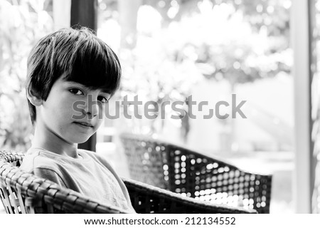 Portrait of a pre-teen in black and white, with ample copy space. - stock photo