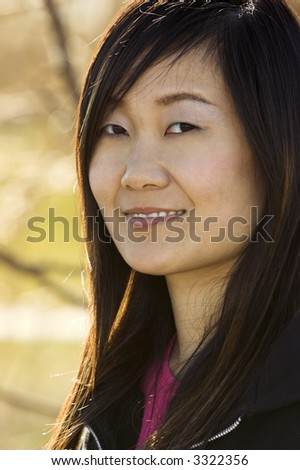 Portrait of a pretty asian woman with backlighting.