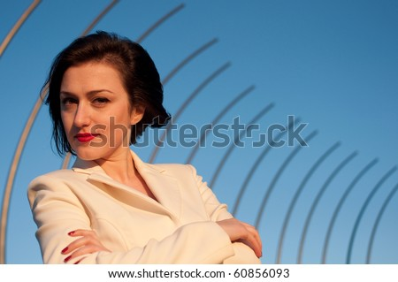 Portrait of a pretty business woman against blue sky background - stock photo
