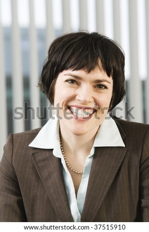 Portrait of a pretty business woman smiling in agreement. - stock photo