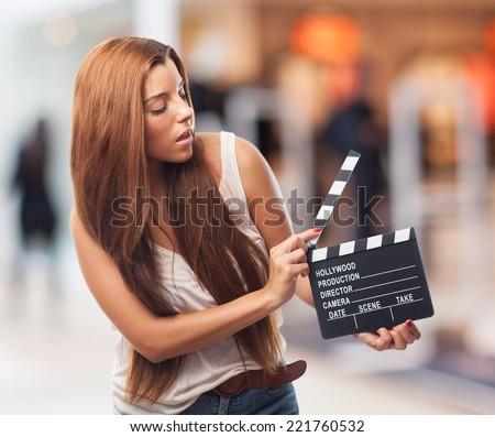 portrait of a pretty girl holding a slate - stock photo