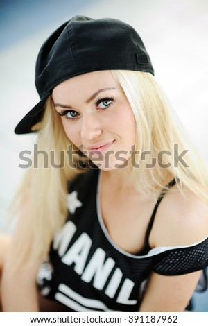 portrait of a pretty girl in a dress in the style of hip-hop