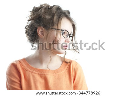 Portrait of a pretty girl looking to the side. Studio photography on a white background. Age of child 10 years. - stock photo