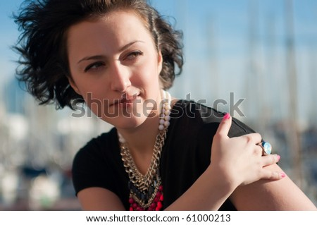 Portrait of a pretty girl oudoors - stock photo
