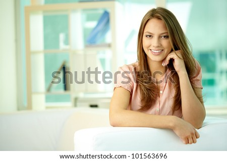 Portrait of a pretty girl smiling and posing in front of the camera - stock photo