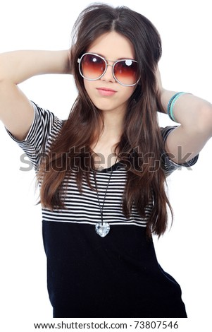 Portrait of a pretty girl teenager. Isolated over white background. - stock photo