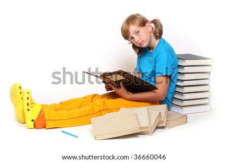 Portrait of a pretty girl with books. - stock photo