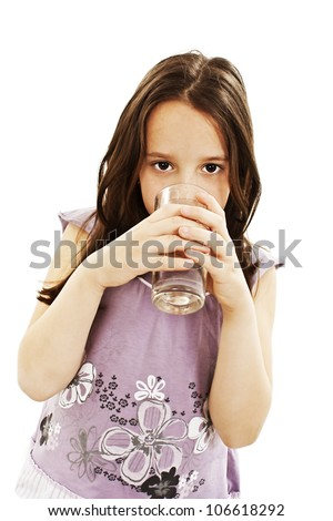 Portrait of a pretty little girl drinking water. Isolated on white background. - stock photo