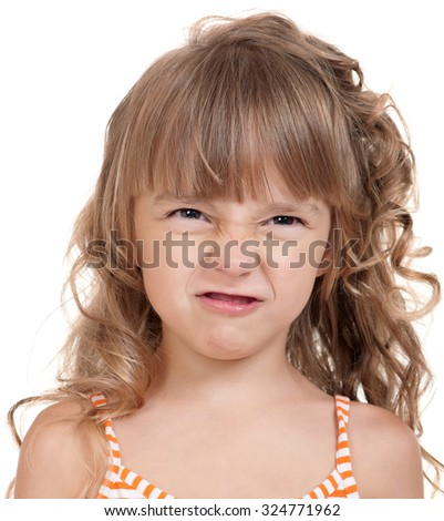 Portrait of a pretty little girl in dress on white background - stock photo