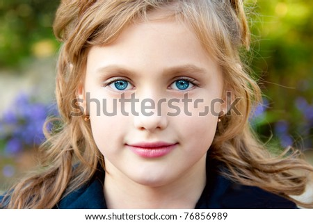 Portrait of a pretty little girl on the background of nature. - stock photo