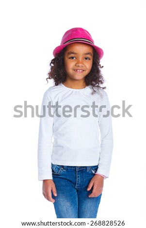 Portrait of a pretty mulatto girl in pink hat smiling at camera on white background - stock photo