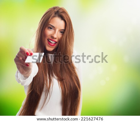 portrait of a pretty woman giving a credit card - stock photo