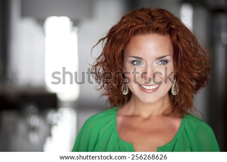 Portrait Of A Pretty Woman Smiling And Looking Away - stock photo