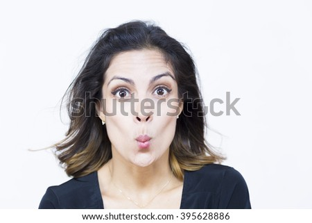 Portrait of a Pretty Woman With Weird Expression Isolated On White - stock photo