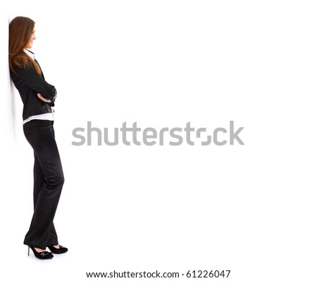 portrait of a pretty young business woman standing isolated on white background - stock photo