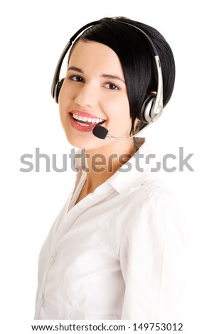 Portrait of a pretty young call center worker wearing a headset  - stock photo