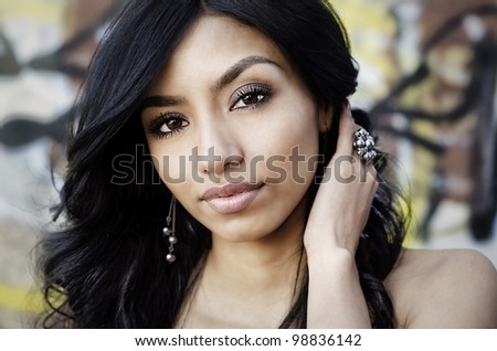 Portrait of a pretty young dark haired woman - stock photo