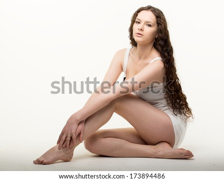 portrait of a pretty young girl sitting on the floor