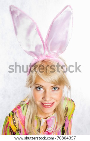 Portrait of a pretty young girl wearing bunny ears - stock photo