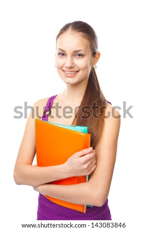 Portrait of a pretty young happy smiling student girl with folders isolated on white background