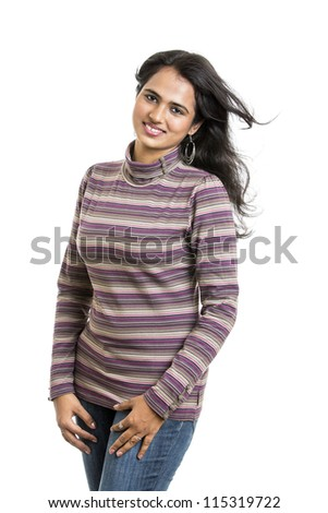 Portrait of a pretty young Indian girl with hair lightly fluttering in the wind - stock photo