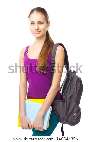 Portrait of a pretty young smiling student girl with books and backpack isolated on white background - stock photo