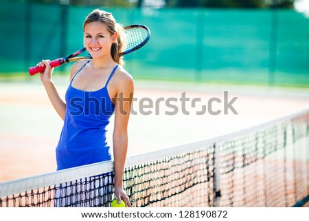 Portrait of a pretty young tennis player with copyspace - stock photo