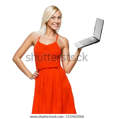 Portrait of a pretty young woman holding a laptop on a white background - stock photo