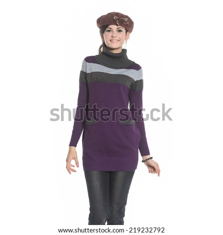 Portrait of a pretty young woman in wearing sweater standing against white background - stock photo