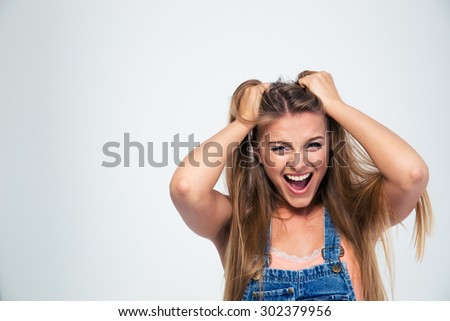 Portrait of a pretty young woman shouting isolated on a white background - stock photo