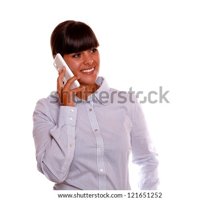 Portrait of a pretty young woman speaking on cellphone against white background - stock photo