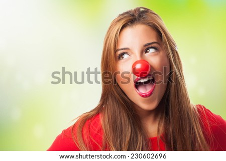 portrait of a pretty young woman wearing a clown costume - stock photo