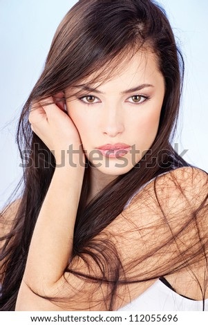 portrait of a pretty young woman with long brunette hair - stock photo