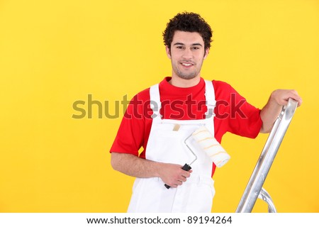 Portrait of a professional house painter - stock photo