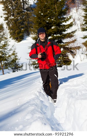 Portrait of a professional nature photographer outdoor in the winter landscape
