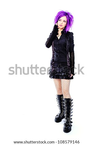 Portrait of a punk girl. Isolated over white background. - stock photo