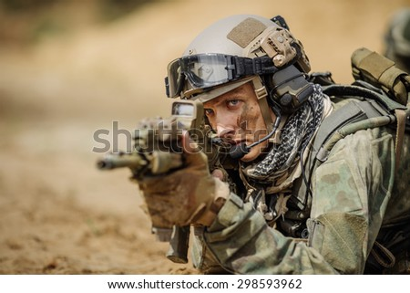 Portrait of a ranger in the battlefield with a rifle - stock photo