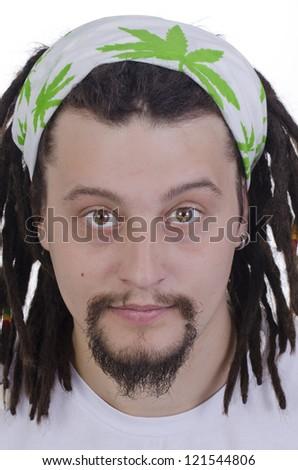 Portrait of a rasta boy with dreadlocks - stock photo