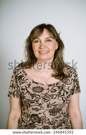 Portrait of a real smiling woman on a light background. Shallow depth of field. Focus on the eyelashes - stock photo