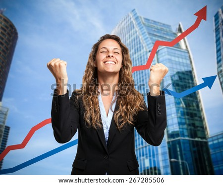 Portrait of a really happy businesswoman. Rising arrow in the background, representing business growth - stock photo