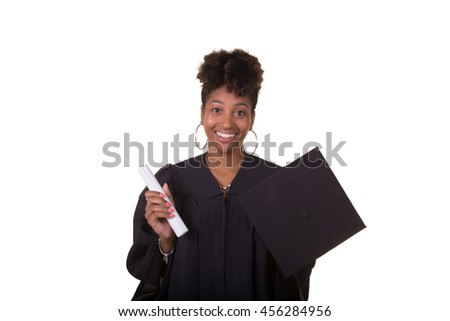 Portrait of a recent college graduate in gown holding her diploma isolated on white - stock photo