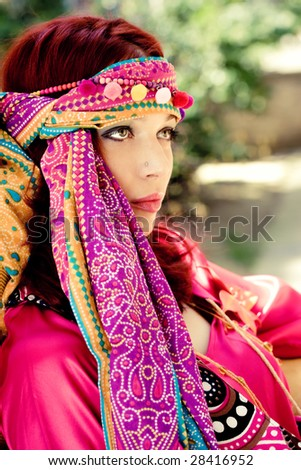 portrait of a red haired woman in colorful clothes, summer day - stock photo