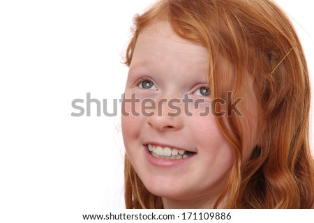 Portrait of a red-haired young girl on white background - stock photo